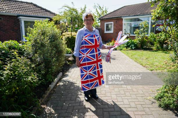A woman wears a Union flag apron as she takes part in celebrations for the 75th anniversary of VE Day on May 08 2020 in Redcar United Kingdom The UK...