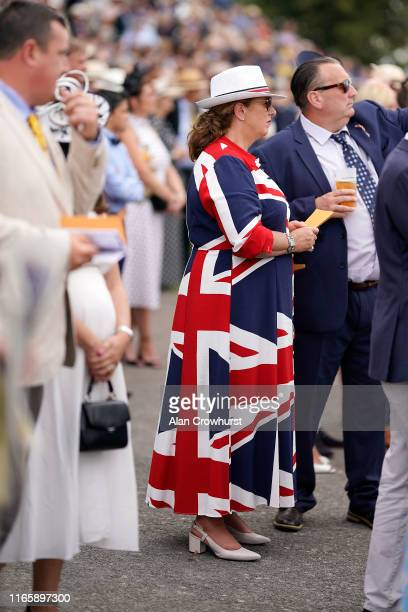 A woman wears a Union Jack dress at Goodwood Racecourse on August 03 2019 in Chichester England
