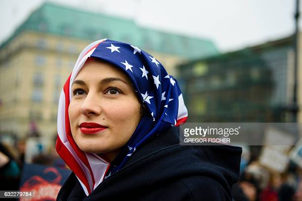 TOPSHOT A woman wears a US flag like a hijab during a protest of US Democrats Abroad in front of the Brandenburg Gate in Berlin on January 21 one day...
