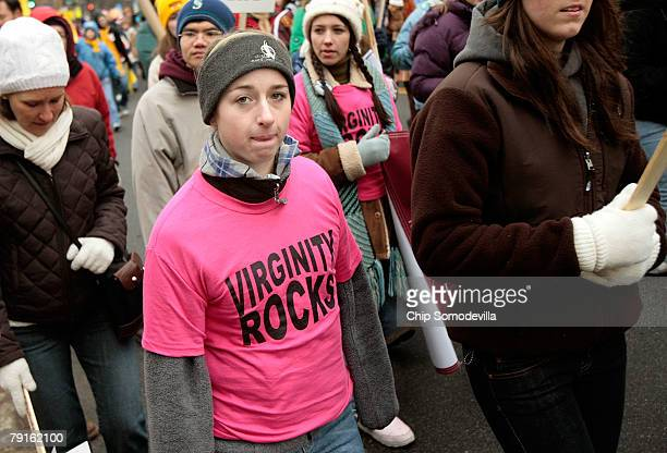 A woman wears a 'Virginity Rocks' tshirt while joining thousands of antiabortion demonstrators participating in the 'March for Life' walk up to...