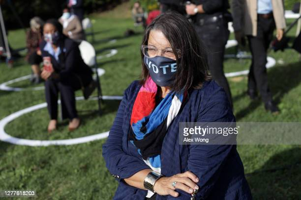 """Woman wears a """"VOTE"""" mask at the launch of a train campaign tour for Democratic presidential nominee Joe Biden at the Cleveland Amtrak Station..."""