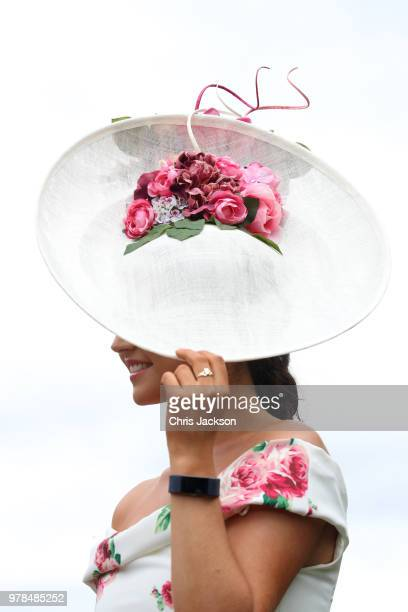 A woman wears a white hat during Royal Ascot Day 1 at Ascot Racecourse on June 19 2018 in Ascot United Kingdom