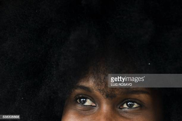 A woman wears an AfroColombian hairstyle during the 12th contest of Afro hairdressers Tejiendo Esperanzas in Cali Valle del Cauca department Colombia...