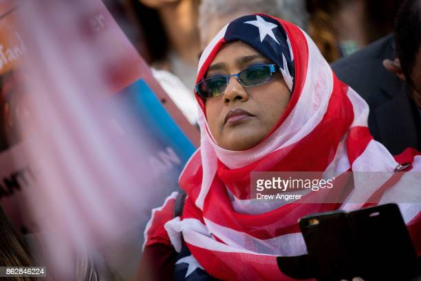 A woman wears an American flag themed hijab as she attends a protest against the Trump administration's proposed travel ban October 18 2017 in...