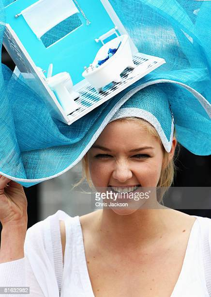 A woman wears an elaborate hat styled on a theme of a bathroom interior during Ladies Day at Royal Ascot racecourse on June 19 2008 in Ascot England