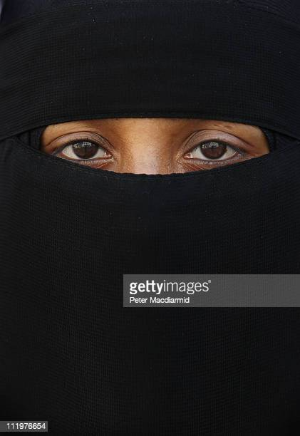 A woman wears an Islamic niqab veil stands outside the French Embassy during a demonstration on April 11 2011 in London England France has become the...