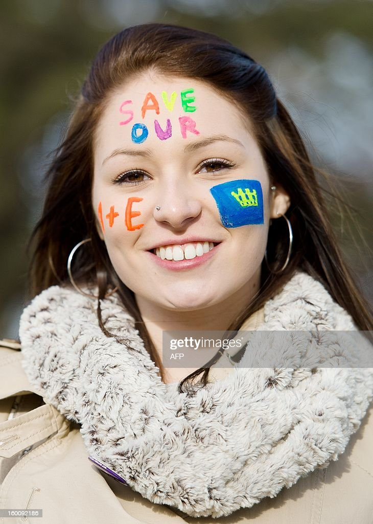 A woman wears face paintduring a demonstration in South-East London on January 26, 2013 to protest against the proposed closure of the Accident and Emergency (A&E) and maternity units at Lewisham hospital. A Government-appointed administrator has recommended that the units be shut down to help tackle the financial crisis at the nearby South London Healthcare NHS Trust. Those protesting argue that leaving a single A&E unit for up to 750,000 people is 'ludicrous and highly dangerous'. AFP PHOTO/Leon Neal