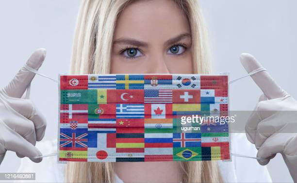 woman wears flags printed mask. - usa stock pictures, royalty-free photos & images
