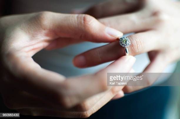 a woman wears her engagement ring - anello gioiello foto e immagini stock