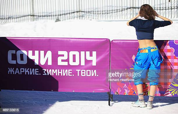 A woman wears her shirt and pants rolled up during the Women's 10 km Classic during day six of the Sochi 2014 Winter Olympics at Laura Crosscountry...