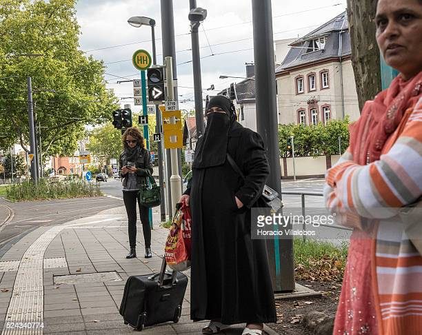 A woman wears niqab at a tram stop in Frankfurt Germany 20 September 2015 Although Germany has so far steered out of the issue Hesse a state run by...