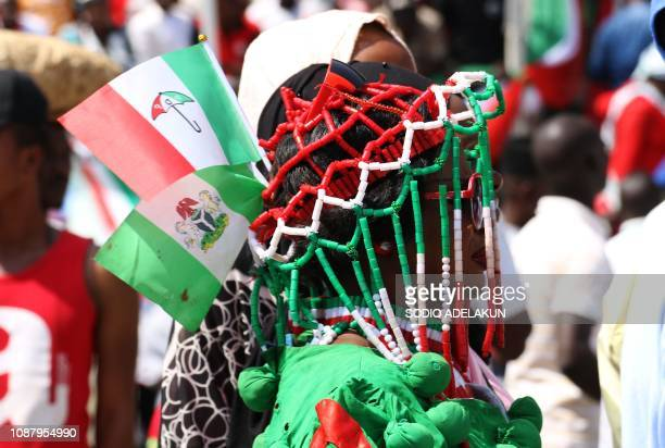 A woman wears People's Democratic Party apparel during a campaign rally of Nigerian PDP opposition presidential candidate Atiku Abubakar at the...