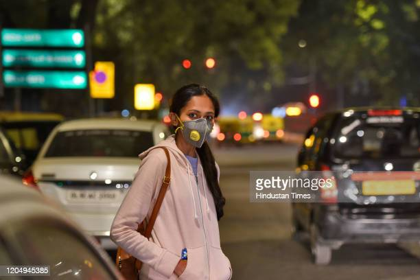 Woman wears protective mask following few positive cases of Coronavirus, on March 3, 2020 in New Delhi, India.