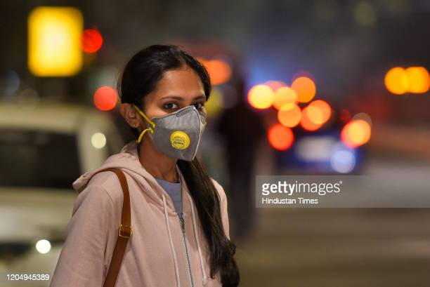 Woman wears protective mask following few positive cases of Coronavirus on March 3, 2020 in New Delhi, India.