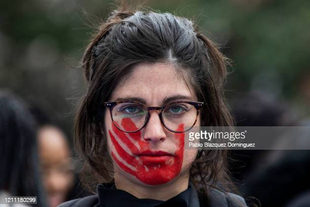 Woman wears red face paint depicting a hand during a protest during the International Women's Day on March 08, 2020 in Madrid, Spain. Spain...