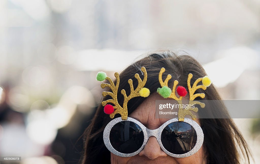 A woman wears reindeer glasses while shopping at the Easton Towne Center in Columbus, Ohio, U.S., on Friday, Nov. 29, 2013. About 97 million people planned to shop online or in stores on Black Friday, with about 140 million intending to do so yesterday through Sunday, the National Retail Federation said. Photographer: Ty Wright/Bloomberg via Getty Images