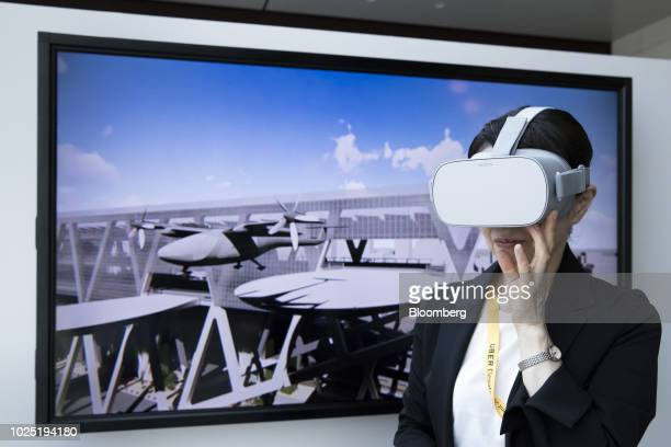 A woman wears virtualreality headsets during an Uber Technologies Inc's demonstration at the Uber Elevated Asia Pacific Expo event in Tokyo Japan on...
