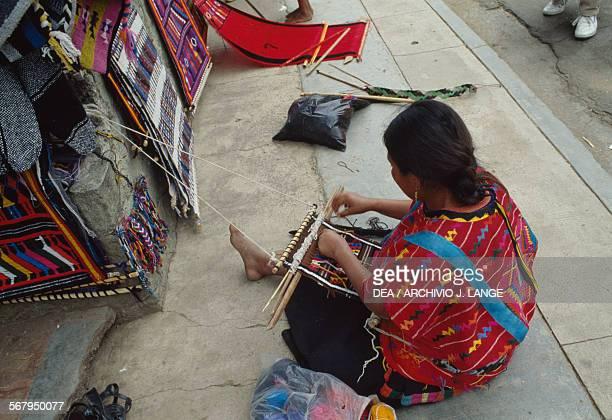 Woman weaving at the indigenous market, Oaxaca, Mexico.