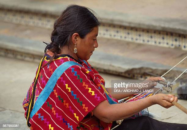 Woman weaving at the indigenous market Oaxaca Mexico