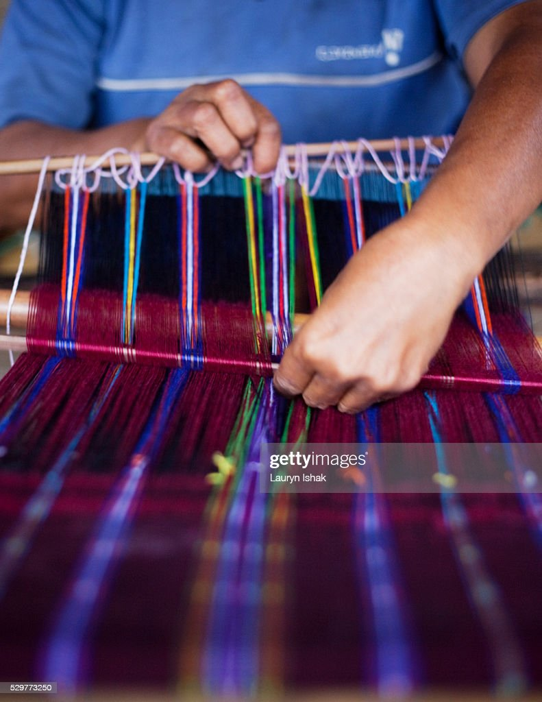 Woman weaving Ikat cloth in Indonesia : Stock Photo