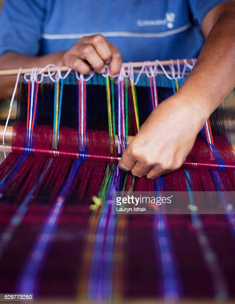 Woman weaving Ikat cloth in Indonesia