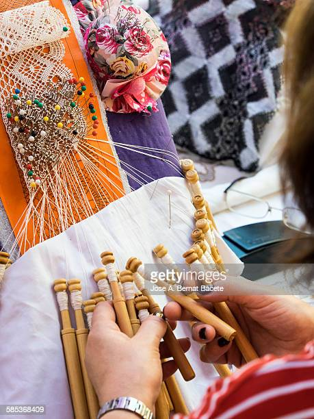 Woman weaving of handcrafted form a fabric