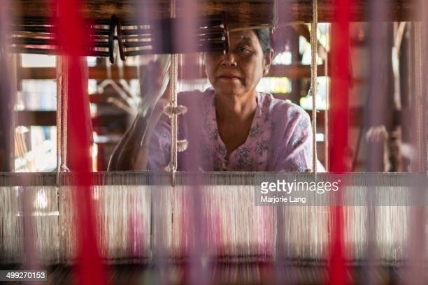 Woman weaving silk in a workshop of Inn Paw Khon, a village on Inle lake, Shan state, Burma . The Inle lake area is renowned for its weaving...