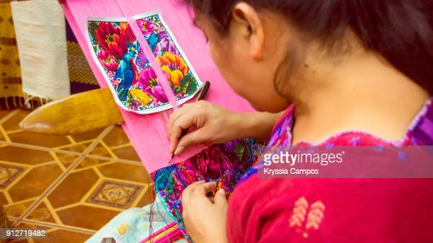 Woman weaving with a backstrap loom at Handicraft Market
