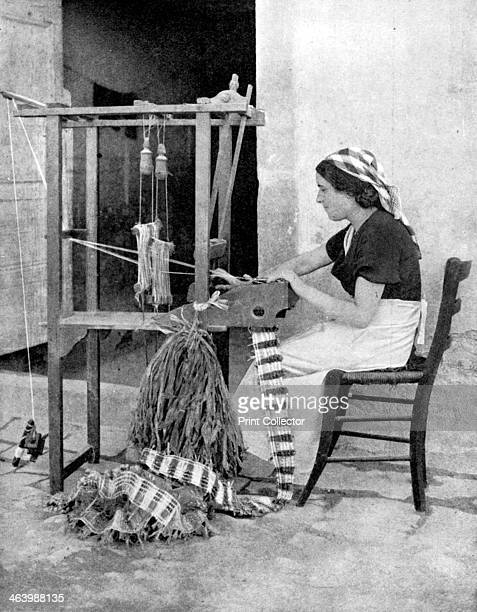 Woman weaving with straw on a hand loom Fiesole near Florence Italy 1936 From Peoples of the World in Pictures edited by Harold Wheeler published by...