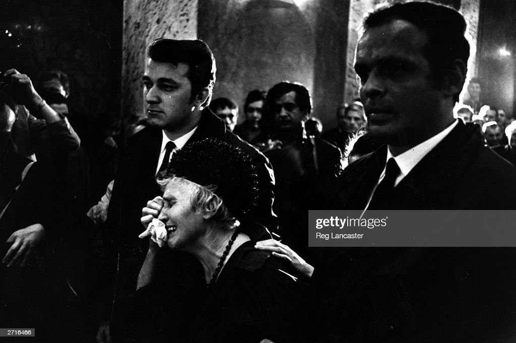 A woman weeping at a funeral for one of the victims of the fighting in Czechoslovakia.
