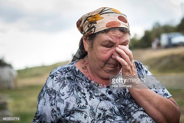 Woman weeps after visiting the crash site of Malaysia Airlines flight MH17 on July 22, 2014 in Grabovo, Ukraine. Malaysia Airlines flight MH17 was...