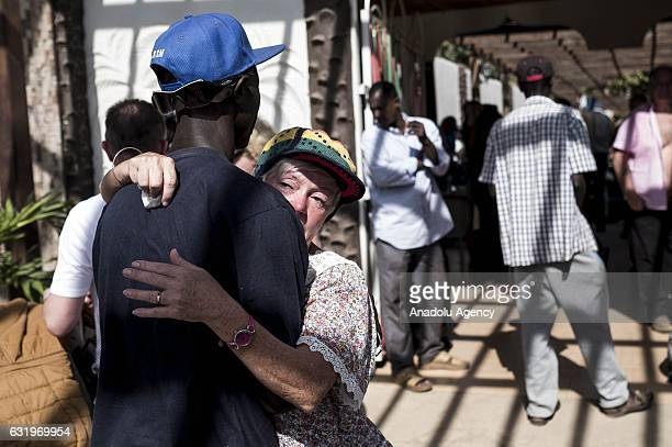 A woman weeps as she prepares to leave the country as the state of emergency declaration by Gambian President Yahya Jammeh at Palma Rima Hotel in...
