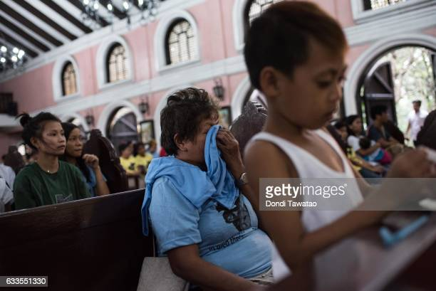 A woman weeps during a mass held for victims of the drug war on February 2 2017 in Manila Philippines Philippine president Rodrigo Duterte said he...