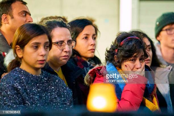 Woman weeps during a memorial service at Western University in London, Ontario on January 8, 2020 for the four graduate students who were killed in a...
