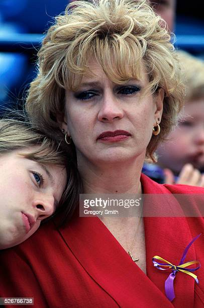 A woman weeps during the Day of Mourning memorial service at the baseball stadium for victims of the Alfred P Murrah Federal Building bombing On...