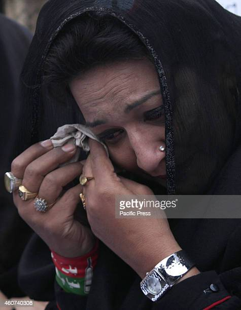 Woman weeps during the tribute for the victims killed in Tuesday's Taliban attack on a militaryrun school in Peshawar in Lahore At least 148 people...