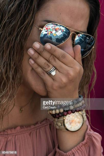 A woman weeps on Las Ramblas near the scene yesterday's terrorist attack on August 18 2017 in Barcelona Spain Fourteen people were killed and dozens...