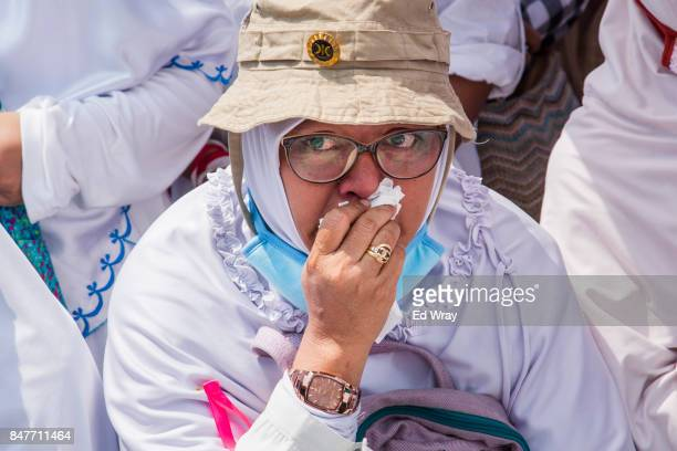 A woman weeps while listening to an account of alleged atrocities as thousands of Indonesian Muslims demonstrate in support of the Rohingya ethnic...