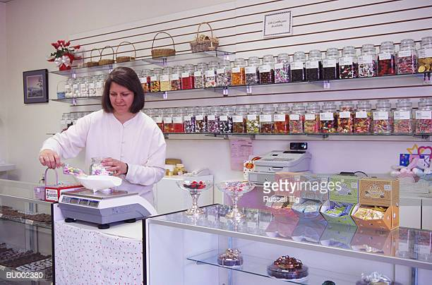Woman Weighing Candy