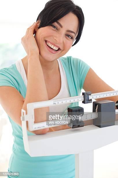 Woman weighing herself