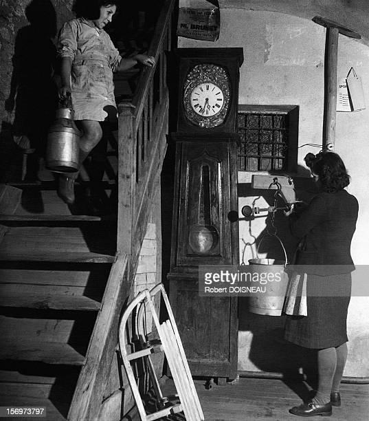 Woman weighing milk, Saint-Veran, 1947 in Saint-Veran, France.