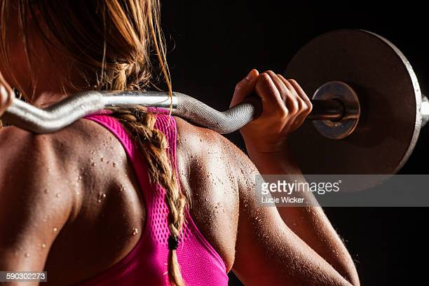 Woman weight lifting on shoulders