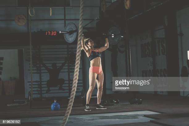woman weightlifting in gym - sporting term stock pictures, royalty-free photos & images