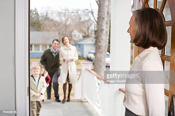 Woman welcoming family