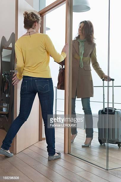 Woman welcoming her friend at doorway