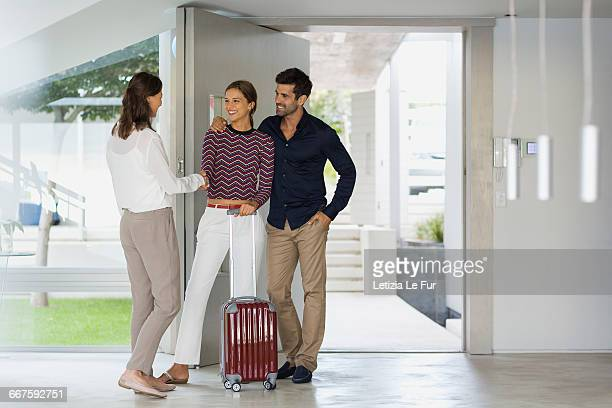 Woman welcoming her friends at doorway