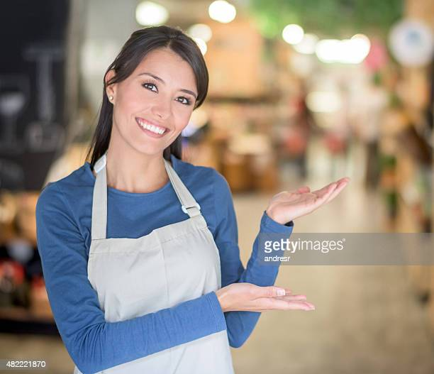 Woman welcoming people to a food market