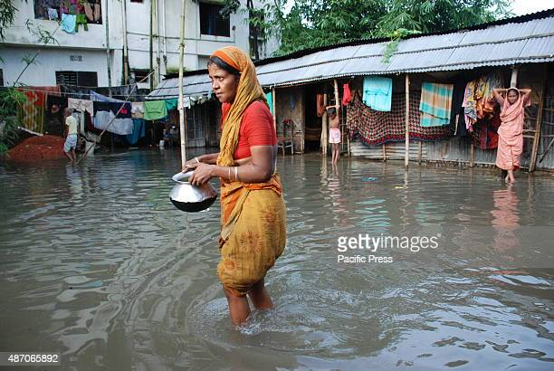 A woman went to someone else's house to cook The flood water enters houses in Sylhet city due to continuous heavy rain there are thousands of...