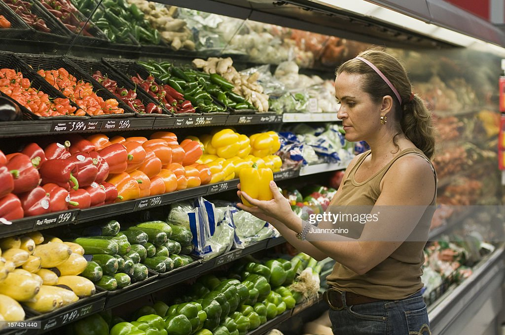 Woman while buying her groceries and vegetables : Stock Photo