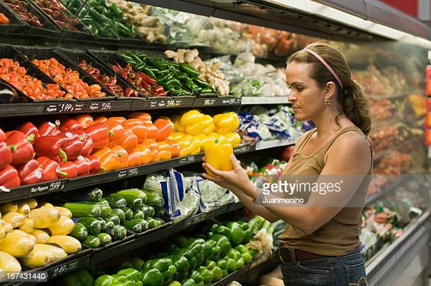 Woman while buying her groceries and vegetables
